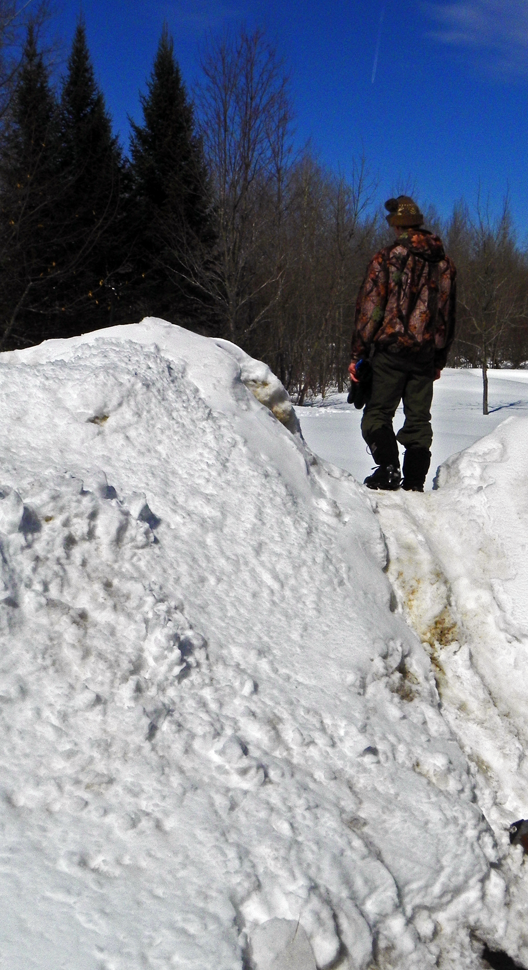Mountains of snow begin to melt after a warm rain